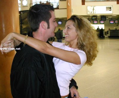 Playboy meets his girlfriend at the airport. He has a secret to keep from her.